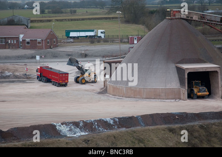 Winsford rock salt mine, with a lorry being loaded with grit for icy roads. - Stock Image