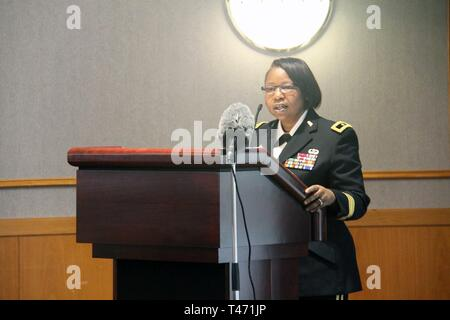 Brig. Gen. Twanda Young, deputy commanding general for the U.S. Army Human Resources Command, speaks to Fort McCoy, Wis., community members at the Women's History Month observance March 14, 2019, at McCoy's Community Center. The theme of the speech was 'empowered women empower women.' - Stock Image