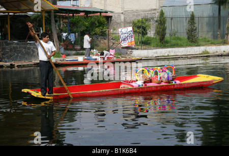 Man Selling Toffee Apples and Sweetmeats on a Boat on the Canals of the Floating Gardens of Xochimilco, Mexico City - Stock Image
