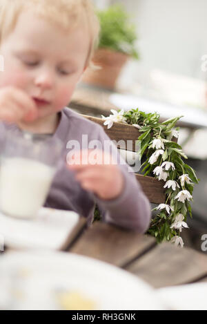 Anemone wreath, girl on foreground - Stock Image