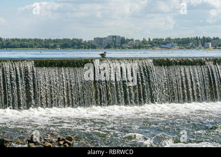 Regulated water flow of that flows through the middle of a city. Russia, Lipetsk. - Stock Image