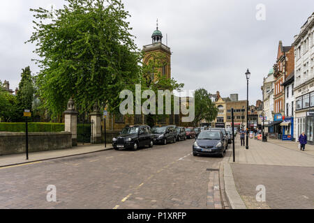 Street scene in Northampton town centre, UK; with a taxi rank to the left and the tower of All Saint's church in the background. - Stock Image