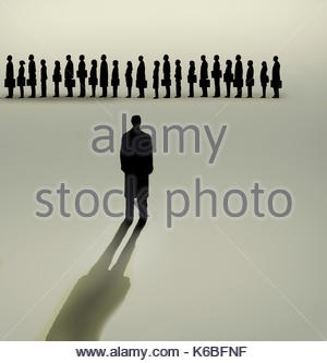 Businessman looking at queue of people waiting in line - Stock Image