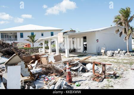 Debris and a damaged oceanfront home in the aftermath of Hurricane Irma November 17, 2017 in Big Pine Key, Florida. - Stock Image