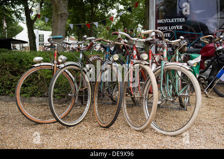 Chichester, West Sussex, UK. 13th Sep, 2013. Goodwood Revival. Goodwood Racing Circuit, West Sussex - Friday 13th September. Vintage cycles outside a shop. © MeonStock/Alamy Live News - Stock Image