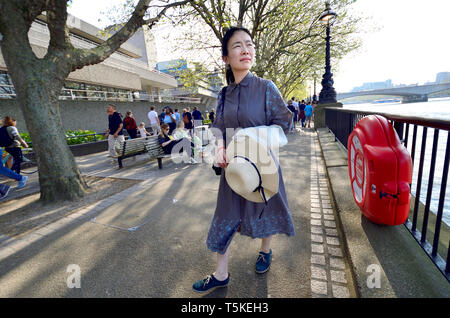 London, England, UK. Japanese woman on the South Bank, by the National Theatre - Stock Image