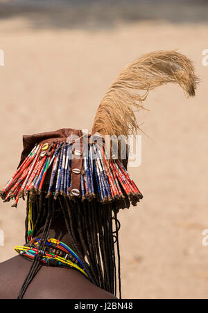 Africa, Namibia, Opuwo. Back view of Himba traditional hat with feather. Credit as: Wendy Kaveney / Jaynes Gallery - Stock Image
