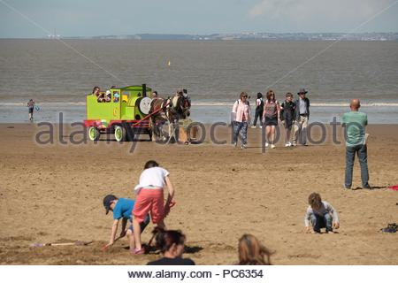 Weston-super-Mare, Somerset. 31st July 2018. UK Weather: the warm weather is back with temperatures set to rise through the week. The tourists and horse rides return to the beach at Weston-s-Mare after a wet damp weekend Credit: Stephen Hyde/Alamy Live News - Stock Image