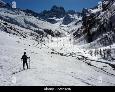 Snowshoeing near Belvedere de Monte Viso, Parc regional de Queyras, France - Stock Image
