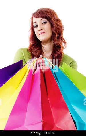 Stock image of female shopper isolated on white background - Stock Image