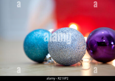 Three glittery sparkly christmas ornaments - Stock Image