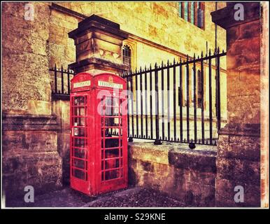 An iconic Red British public Telephone box or booth. The advent of cellphones has hastened their demise. A grunge picture with creative atmosphere. Photo Credit - © COLIN HOSKINS. - Stock Image