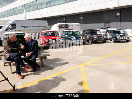 Tiff Needell interviewing mini rallying  legend Paddy Hopkirk MBE, in the International Paddock, during the Silverstone Classic Media Day 2019 - Stock Image