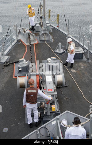 180828-N-ZS023-1021 LOS ANGELES (August 28, 2018) Sailors assigned aboard the Avenger-class Mine Countermeasures ship USS Scout (MCM 8), participate in participate in a sea-and-anchor detail on the forecastle before pulling into port to begin Los Angeles Fleet Week (LAFW).  LAFW is an opportunity for the American public to meet their Navy, Marine Corps and Coast Guard teams and experience America's sea services.  During fleet week, service members participate in various community service events, showcase capabilities and equipment to the community, and enjoy the hospitality of Los Angeles and  - Stock Image