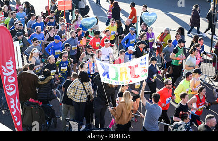 Brighton, UK. 24th Feb, 2019. Runners head along the seafront in the Grand Brighton Half Marathon on a beautiful sunny morning . Over 13000 runners were expected to take part in aid of the Sussex Beacon charity Credit: Simon Dack/Alamy Live News - Stock Image