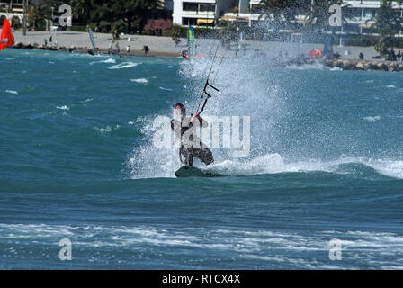 Kite boarder  during a windy day at the end of winter in French riviera. (St Laurent du Var spot) - Stock Image