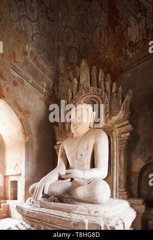 Buddha statue and paintings in a temple near Alotawpyae temple, Old Bagan and Nyaung U village area, Mandalay region, Myanmar, Asia - Stock Image