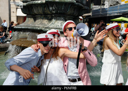 Danish students celebrate their high school graduation with the traditional dance round and plunge into the Stork Fountain on Stroeget in Copenhagen. - Stock Image
