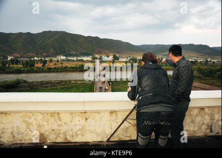 Jilin,China - Oct 4,2012:China's border with North Korea in Jilin, Chinese tourists are watching the Korean - Stock Image