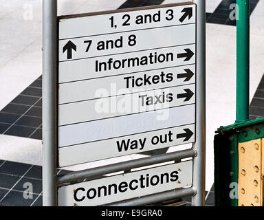Direction or information sign at an English Train Station generally run by british rail and used to guide commuters. - Stock Image