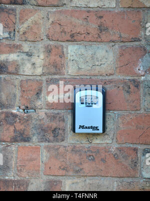 Combination secure key box on outside wall of a property on Old Town, Stratford upon Avon, Warwickshire - Stock Image