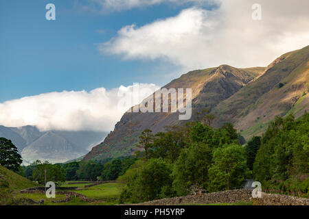 The Cumbrian Mountains, shrouded in mist on a sunny day - Stock Image