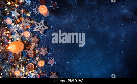 Christmas background with wooden decorations and candles. Free space for text. Celebration and decorative design. - Stock Image