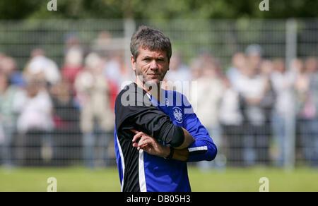 The head coach of Bundesliga club Eintracht Frankfurt, Friedhelm Funkel, looks sceptical during a training session - Stock Image