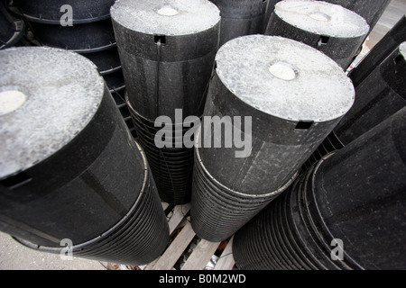 A wide angle shot of a stack of gardening pots. - Stock Image