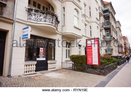 Poznan, Poland - March 8, 2019: Synevo medical office entrance in a apartment building on the Slowackiego street. - Stock Image