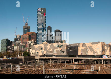 Overlooked by the 297-metre Eureka Tower on Southbank, the Federation Square complex and the CBD are seen from Birrarung Marr park, Melbourne - Stock Image