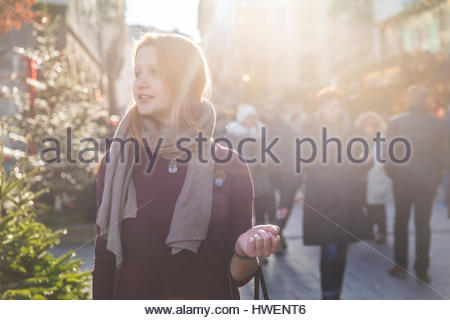 Young woman shopping at christmas market - Stock Image