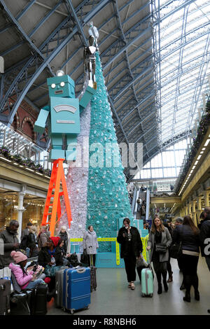 Tiffany & Co Christmas tree and robot and people in the shopping mall area at St Pancras International Railway Station in London UK  KATHY DEWITT - Stock Image