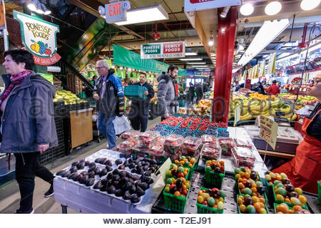 Shopping for groceries in St. Lawrence Market food market on a Saturday morning in downtown Toronto Ontario Canada. - Stock Image