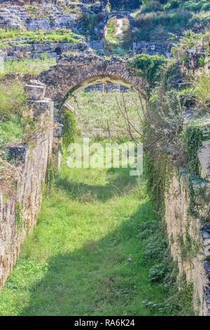 The  Roman Amphitheatre Della Neapolis Archeological Park, Syracuse, Italy - Stock Image
