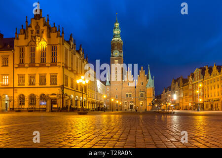 Gothic town hall and colorful houses on Market Square during morning blue hour in the Old Town of Wroclaw, Poland - Stock Image