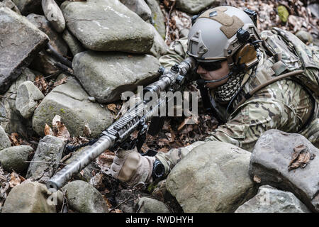 United States Army ranger sniper in the forest. - Stock Image