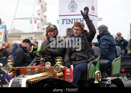 Close-up of Mr Cliff Jowsey driving his 1902 Renault, across the finishing line in the 2018 London to Brighton Veteran Car Run - Stock Image