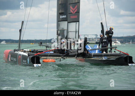 Portsmouth, UK. 25th July 2015. Oracle Team USA make final preparations just prior to the start of racing on the - Stock Image