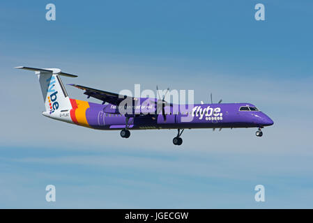 An Flybe internal Scheduled flight on approach to Inverness Dalcross Airfield in the Scottish Highlands. UK. - Stock Image