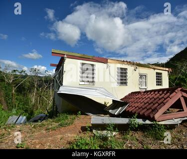 A home damaged by a landslide in the aftermath of Hurricane Maria November 2, 2017 in Lares, Puerto Rico.   (photo - Stock Image