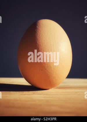 Farm fresh organic brown egg - Stock Image