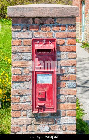 Red British style Victorian pillar box in Trinity, Newfoundland. - Stock Image