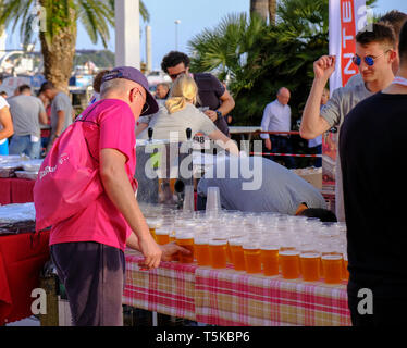 Split Croatia, April 25, 2019 : After the finish line at B2Run Business race, Runner grabbing a beer from table after the race - Stock Image