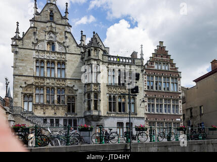 The historical brick buildings at the shore of the Lys river in Ghent, Belgium. - Stock Image