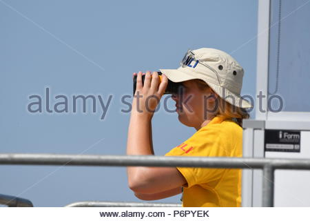 Littlehampton, UK. Monday 2nd July 2018. A lifeguard keeping watch on another very warm and humid morning in Littlehampton, on the South Coast. Credit: Geoff Smith / Alamy Live News. - Stock Image