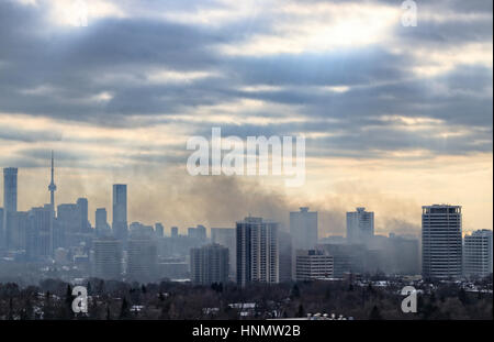 Toronto, Canada. 14th Feb, 2017. Massive smoke spreading into the sky after 6-alarm fire broke out from historic - Stock Image