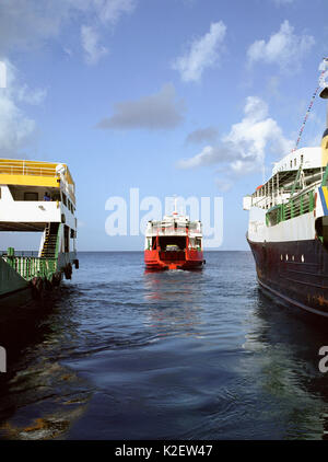 A ferry leaves for Canouan Island. Kingstown, St. Vincent. West Indies. - Stock Image