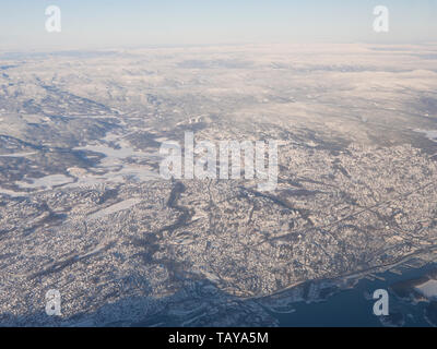 Aerial photo of parts of Eastern Norway on a sunny winters day, Baerum and Oslo west with the Nordmarka forest - Stock Image