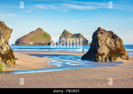 24 June 2018: Holywell, Cornwall, UK - Rocks on Holywell Beach, with a view through  to Carters Rocks, Cornwall, UK. - Stock Image